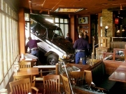 Suffolk County police look at a truck that crashed into a Houlihans restaurant in Lake Grove Thurdsay, March 11, 1999. Initial police reports said the driver sustained minor injuries. It took police over an hour to remove the truck and the restaurent had to be closed. (Ed Betz)